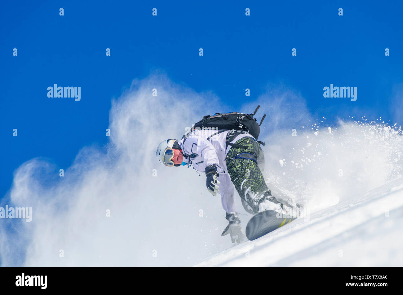 Snowboarder during a downhill in backcountry - Stock Image