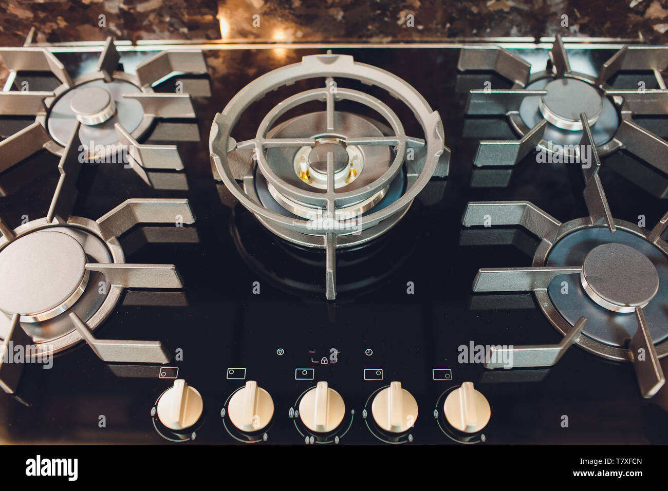 Cooking on a modern design gas stove burner - kitchen tools details - Stock Image