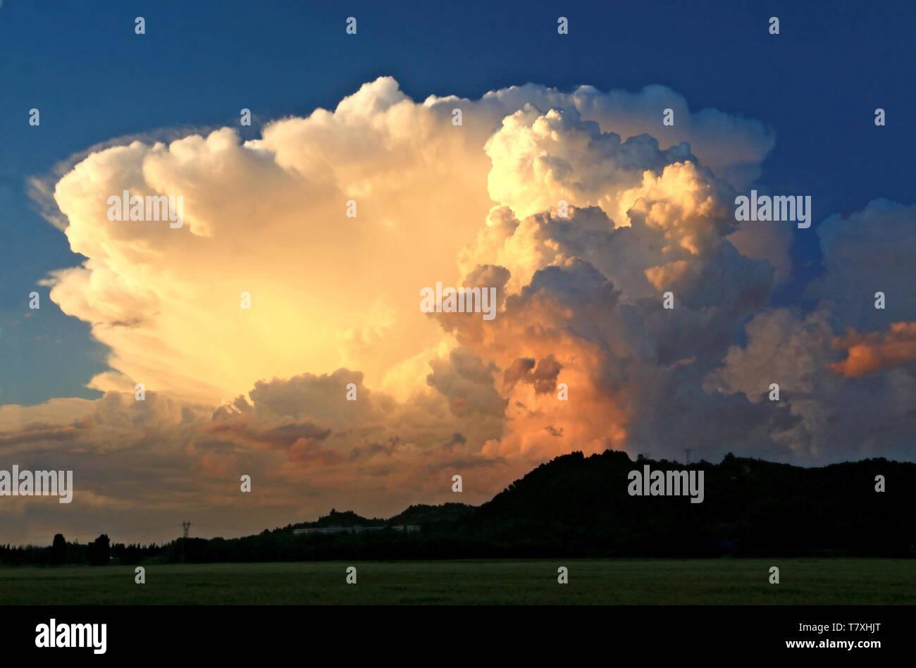 Cumulonimbus in summer at sunset. - Stock Image