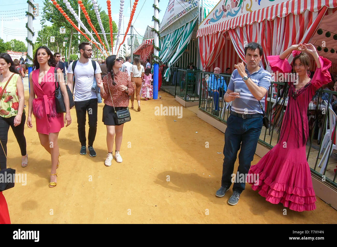 Seville, Spain - May 5, 2019: People walking in the April Fair of Seville on May, 5, 2019 in Seville, Spain - Stock Image