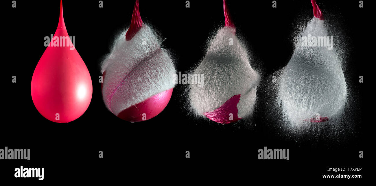Sequence of the explosion of a balloon full of water - Stock Image