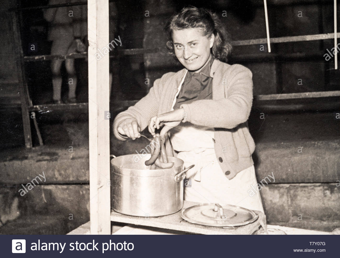 cooking saucages in a big pot France ca 1950s - Stock Image