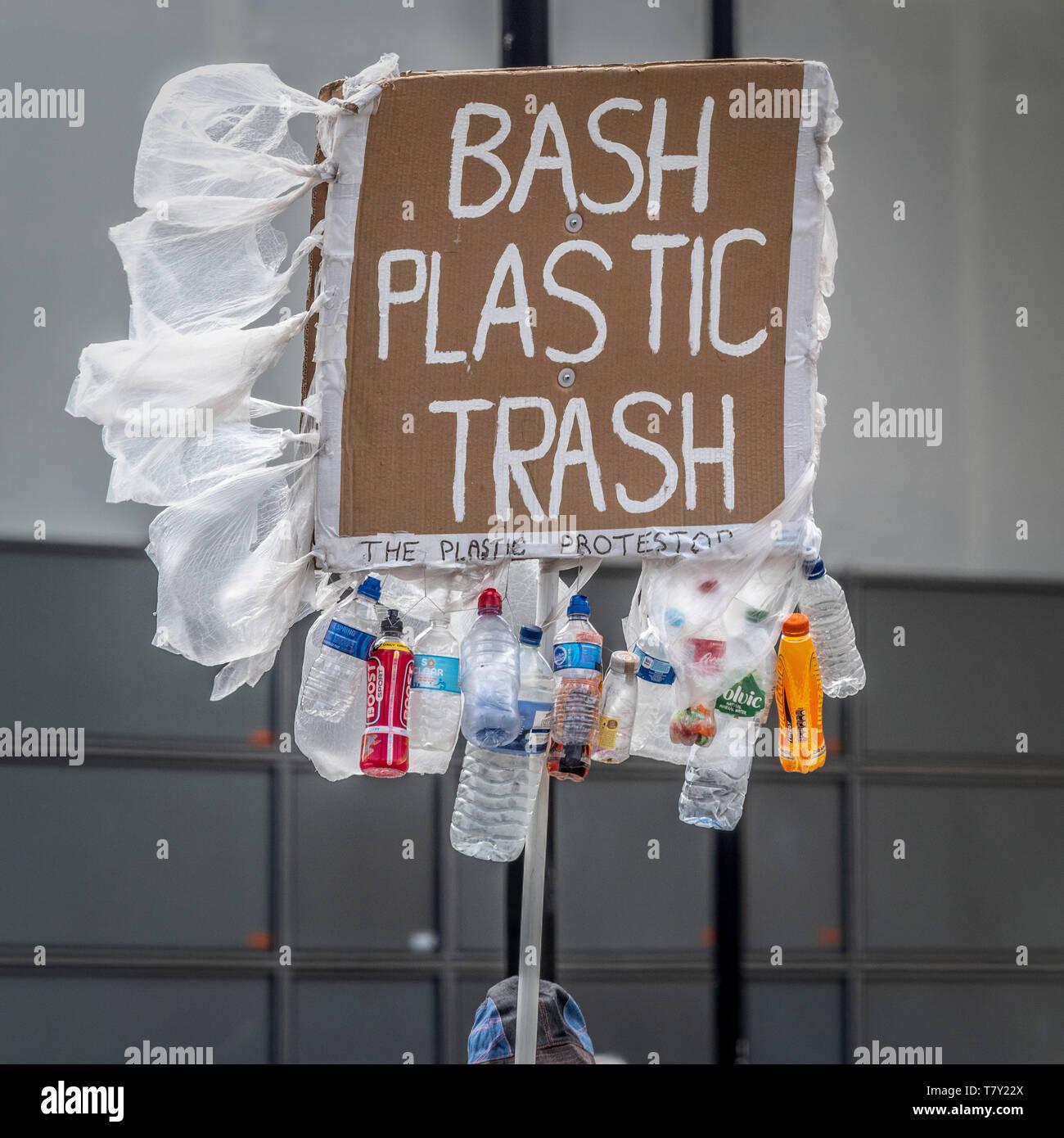 Bash Plastic Trash protester's placard outside Westminster, London, UK. - Stock Image