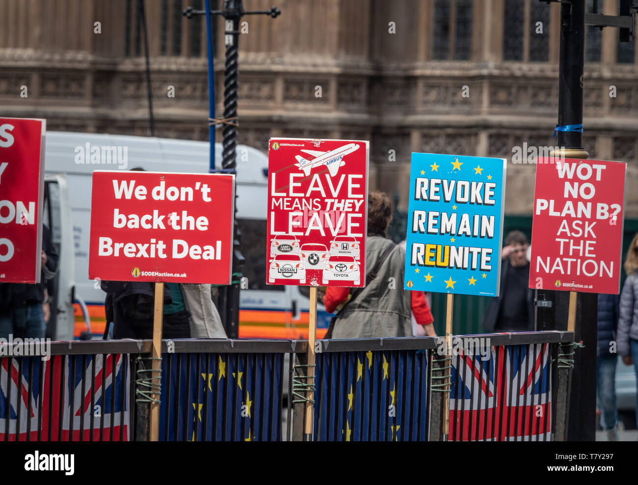 Anti-Brexit placards fastened to railings outside Westminster, London, UK. - Stock Image