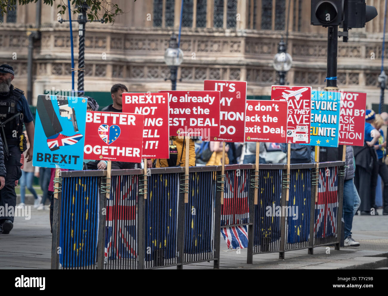Anti-Brexit placards fastened to railings outside Westminster, London, UK. Stock Photo