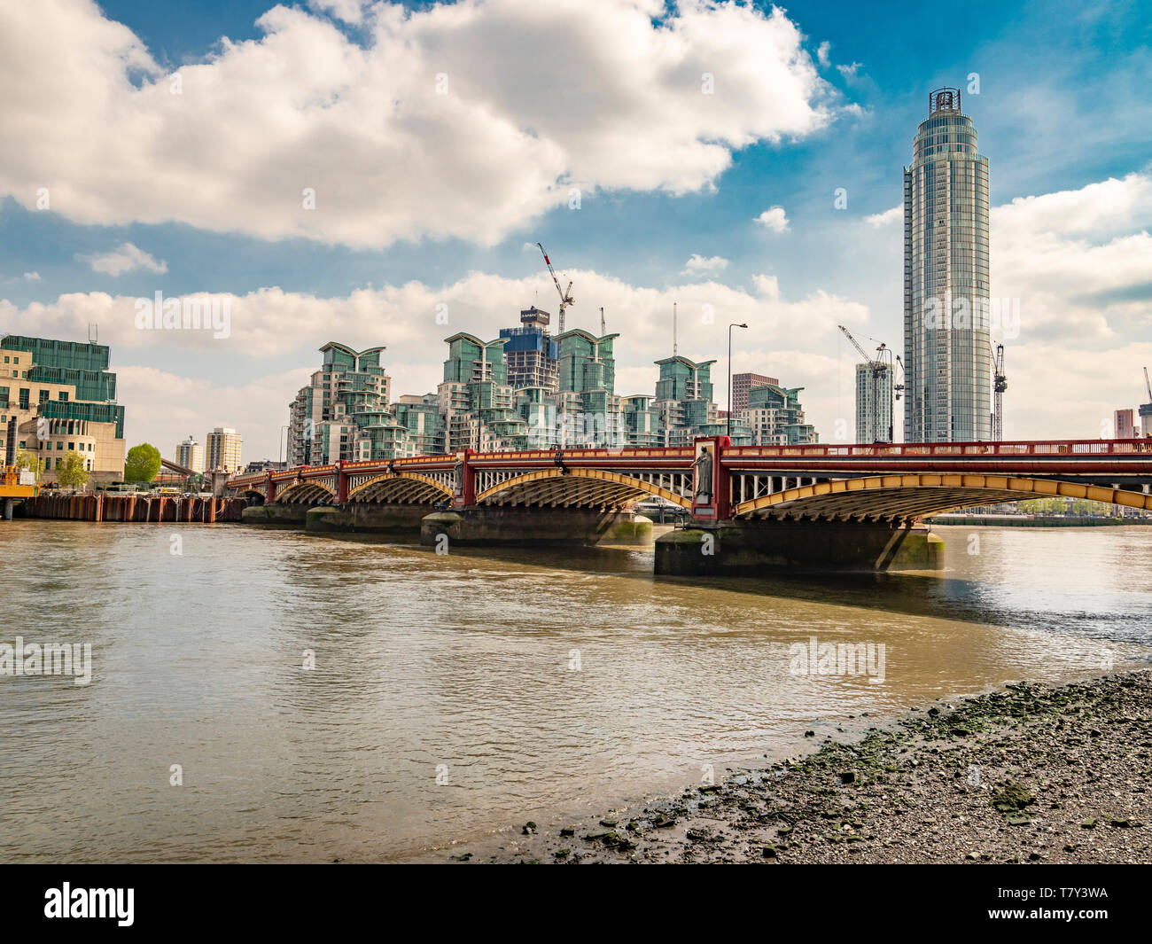 Vauxhall Bridge over the river Thames with St George Wharf Tower and development of apartments in the background, London, UK. - Stock Image