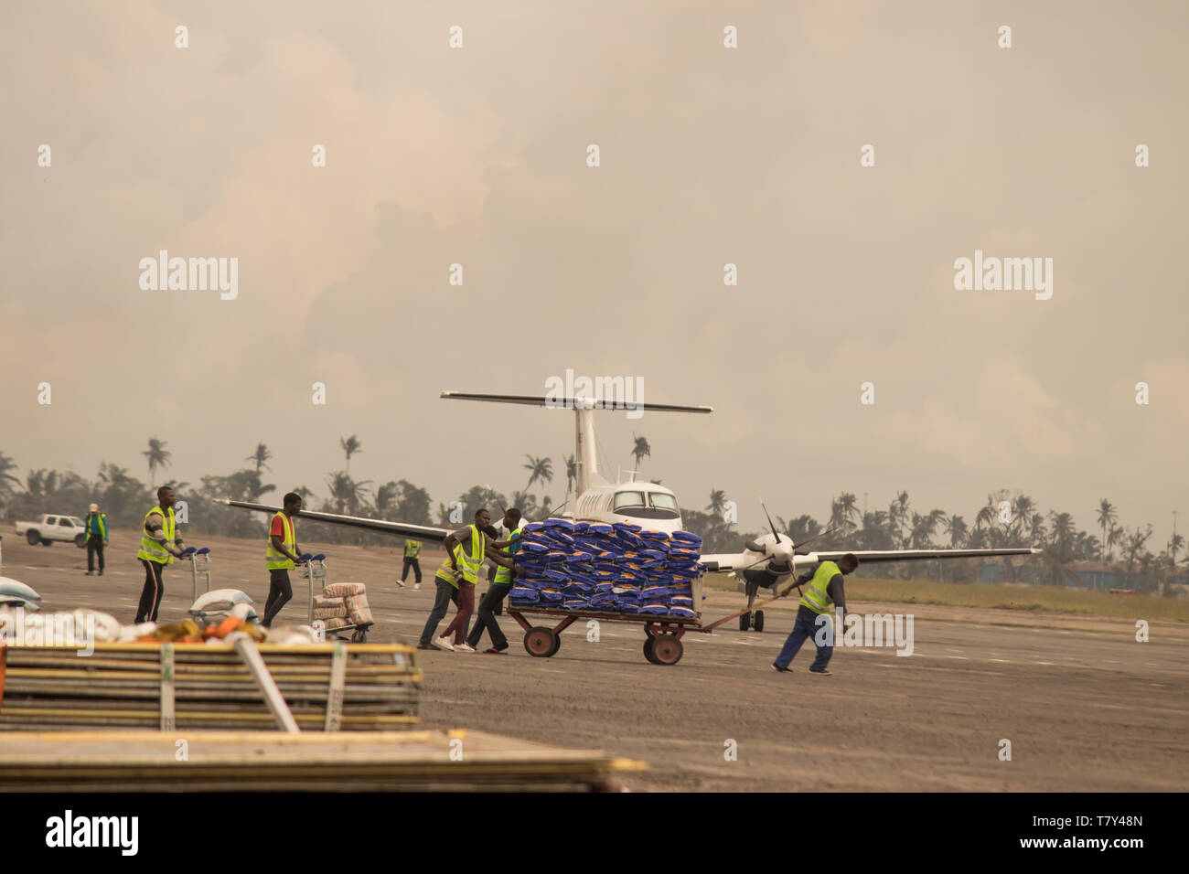 Aftermath Cyclone Idai and Cyclone Kenneth in Mozambique and Zimbabwe, humanitarian workers preparing humanitarian help to deliver for affected people - Stock Image