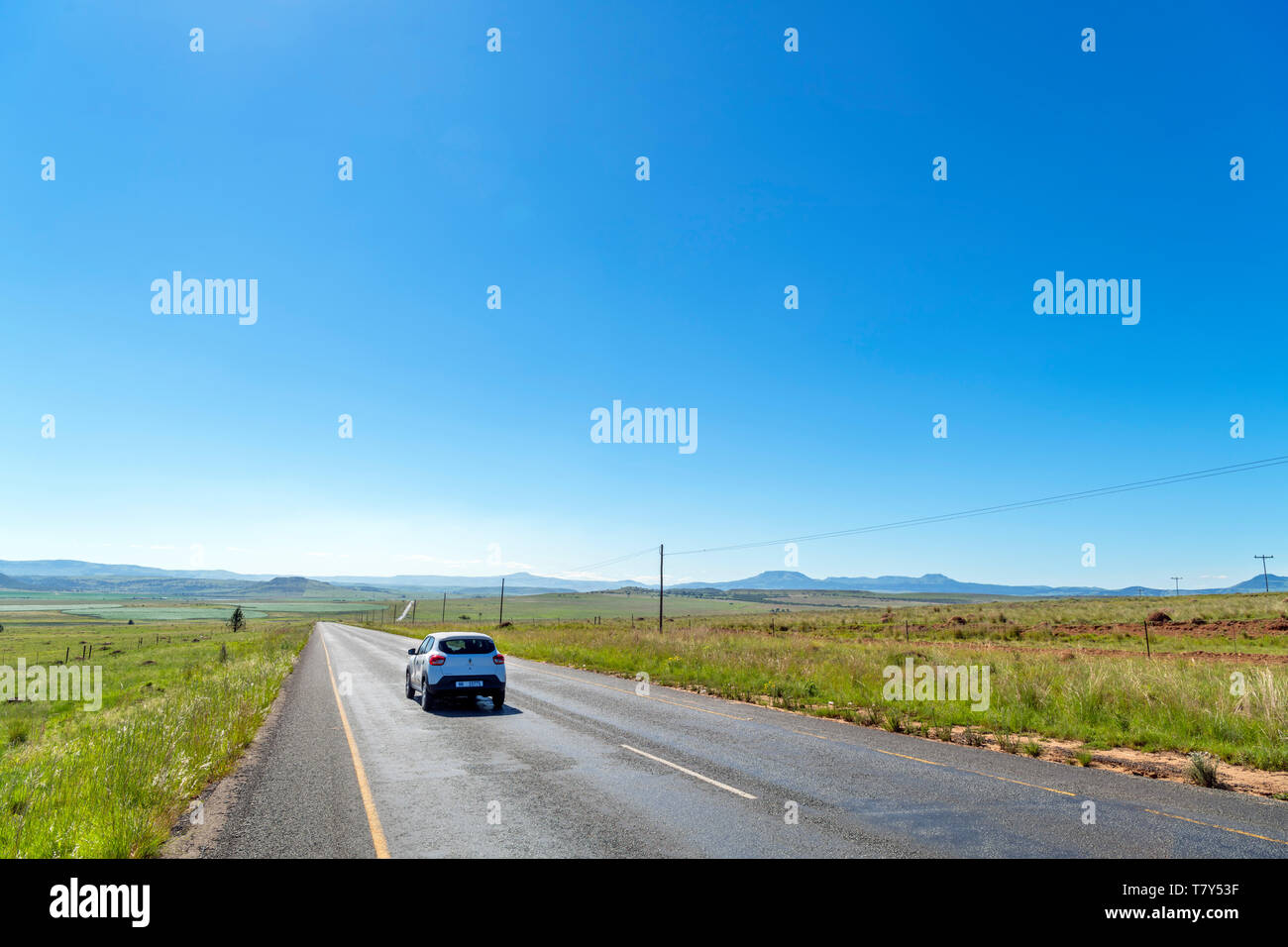 Car driving on the R34 highway near Newcastle, KwaZulu-Natal, South Africa - Stock Image