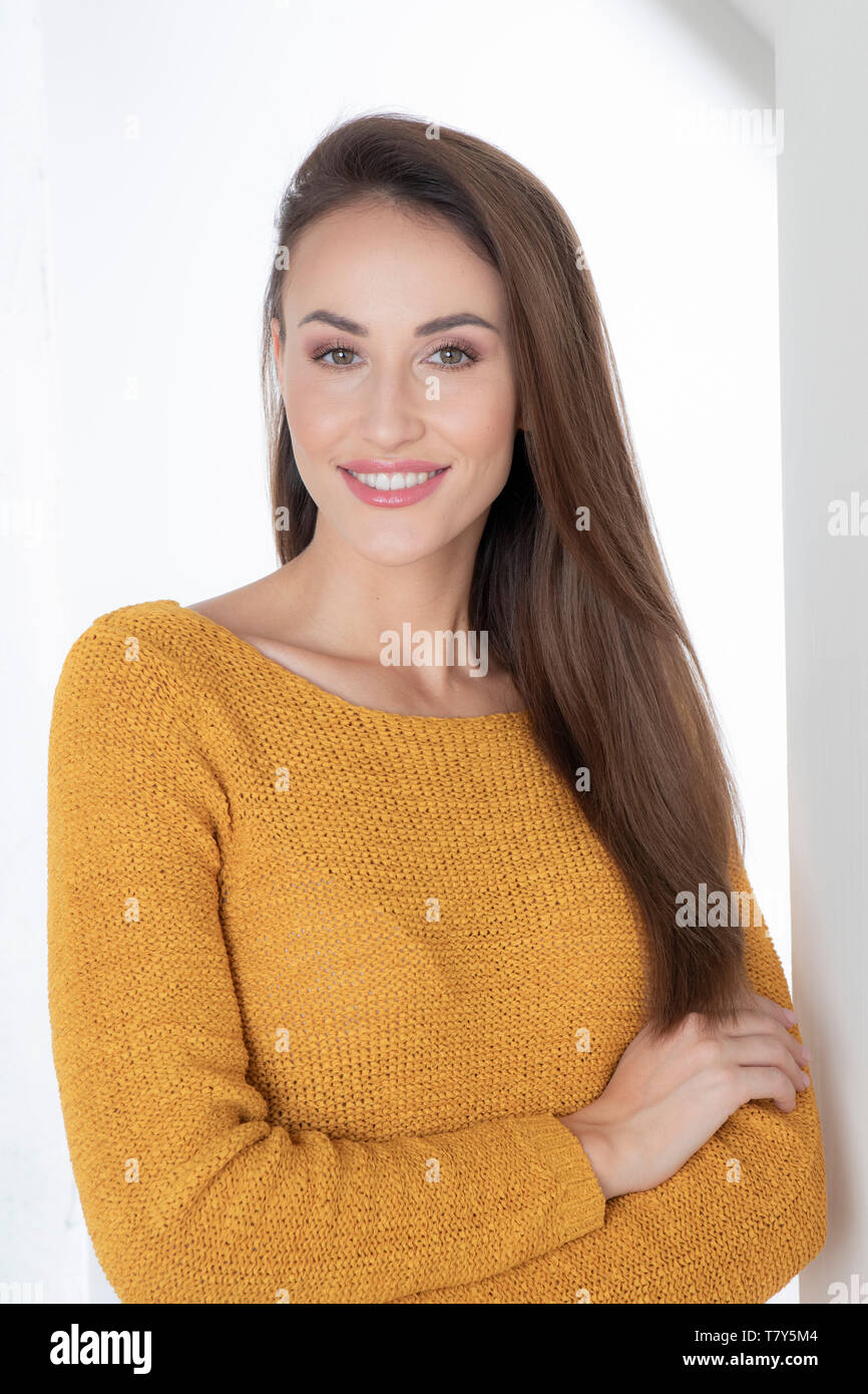 Portrait of young woman wearing sweater Stock Photo