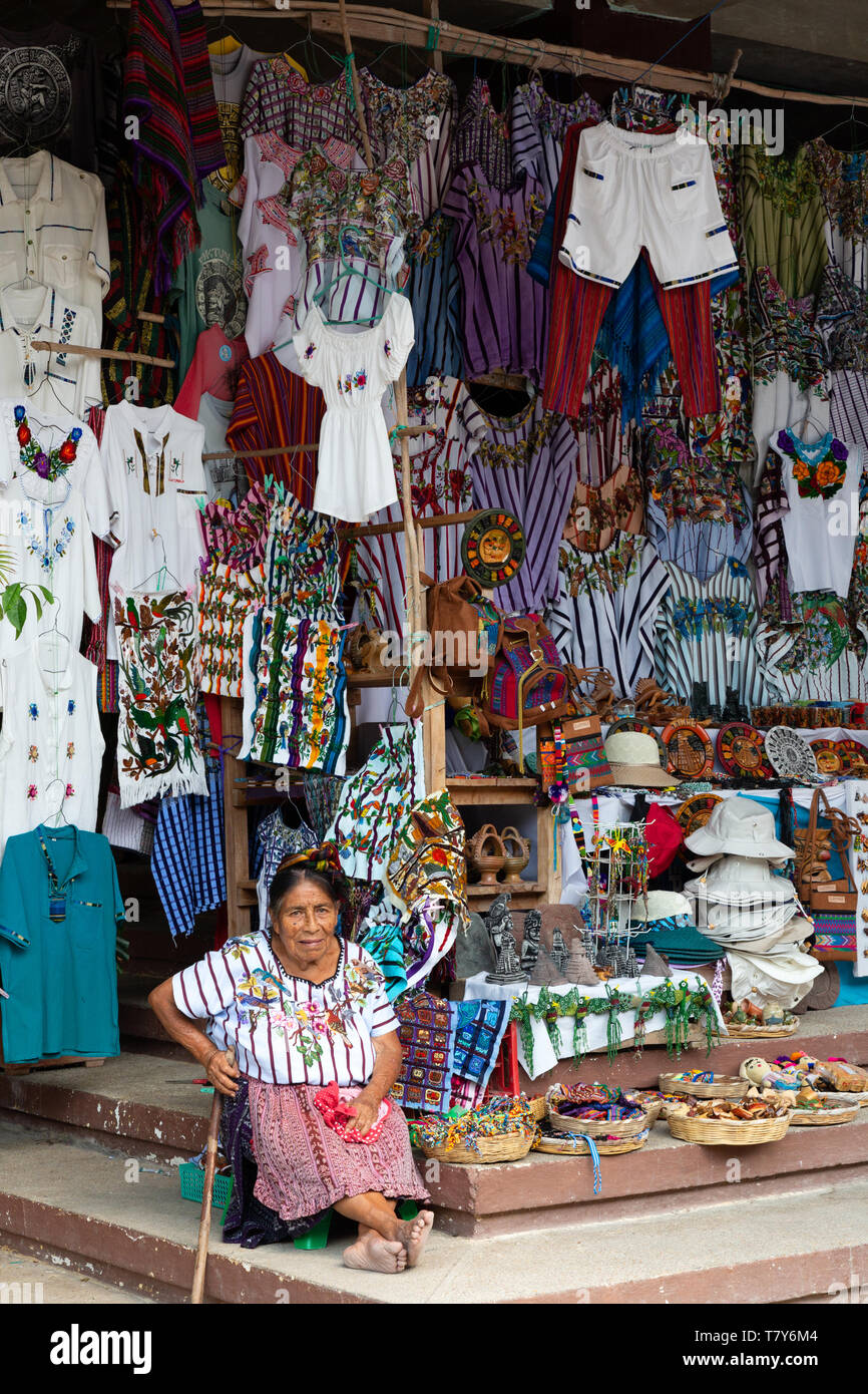 Guatemala market stall and senior guatemalan woman selling her goods, example of Central American lifestyle; north-east Guatemala, Central America - Stock Image