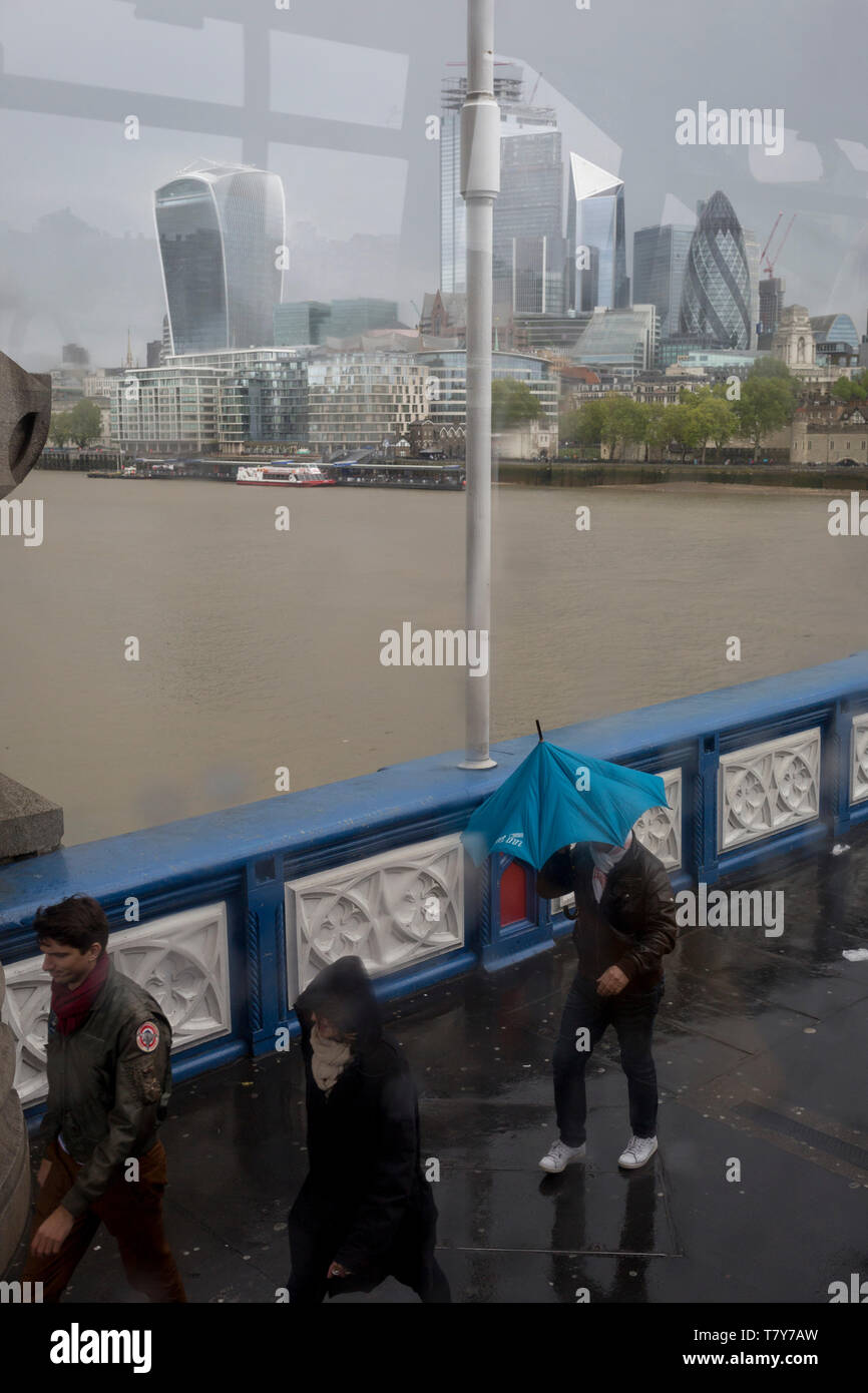 Tourists brave a wet and windy Tower Bridge, on Tower Bridge, on 8th May 2019, in London, England. Stock Photo