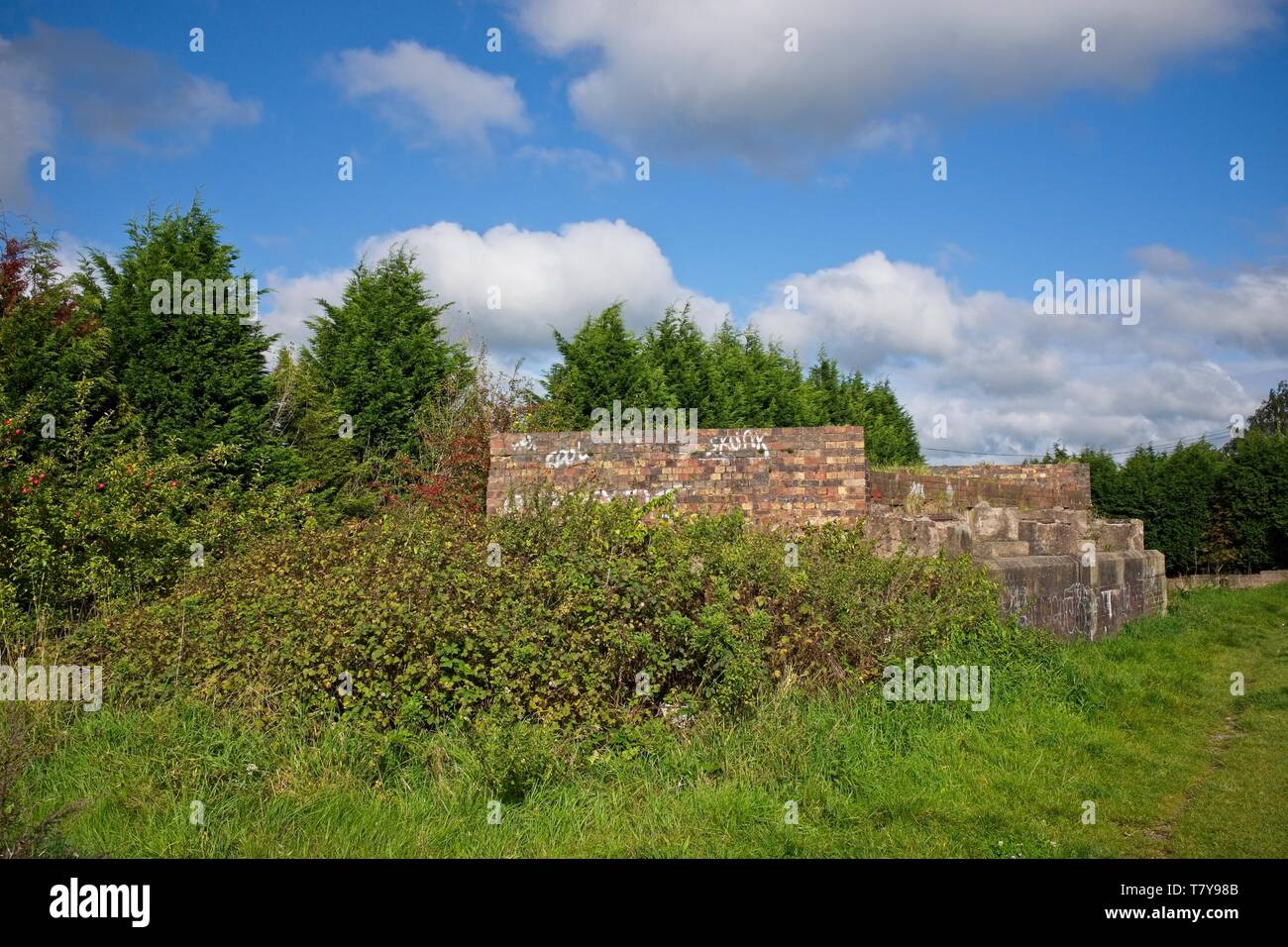 Remains of a demolished bridge or bridge foundation over the Trent and Mersey canal in Moston Cheshire UK - Stock Image
