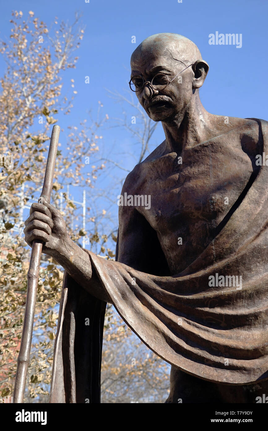 A closed up view of the bronze statue of Mahatma Gandhi in front of Embassy of India.Dupont Circle.Washington D.C.USA - Stock Image