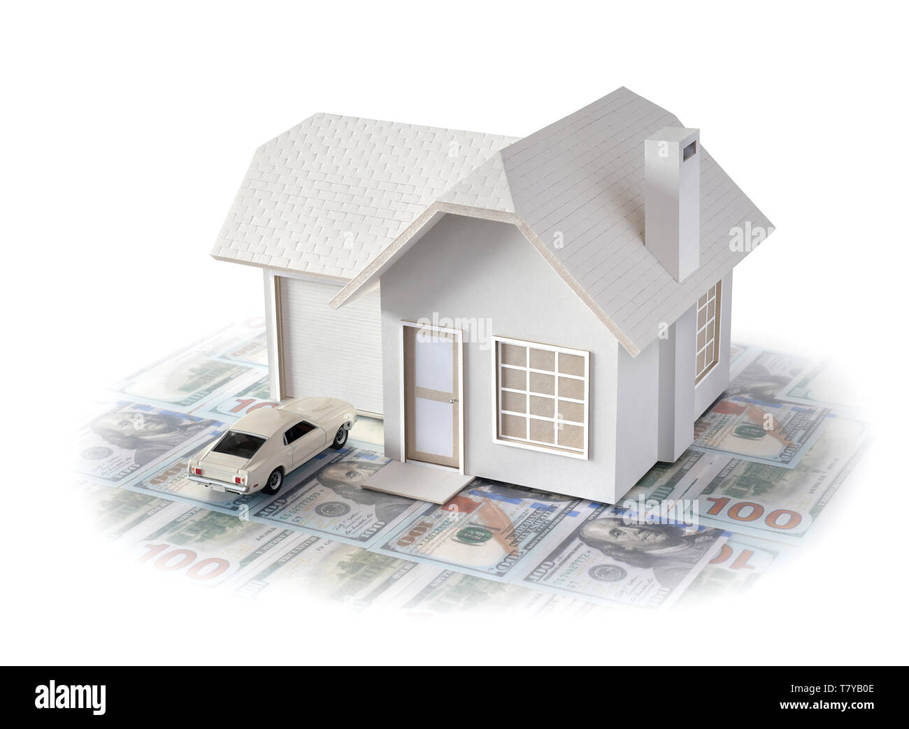 House miniature w/ car on U.S. dollar bills isolated in white background for real estate & construction concepts. House miniature made by contributor - Stock Image