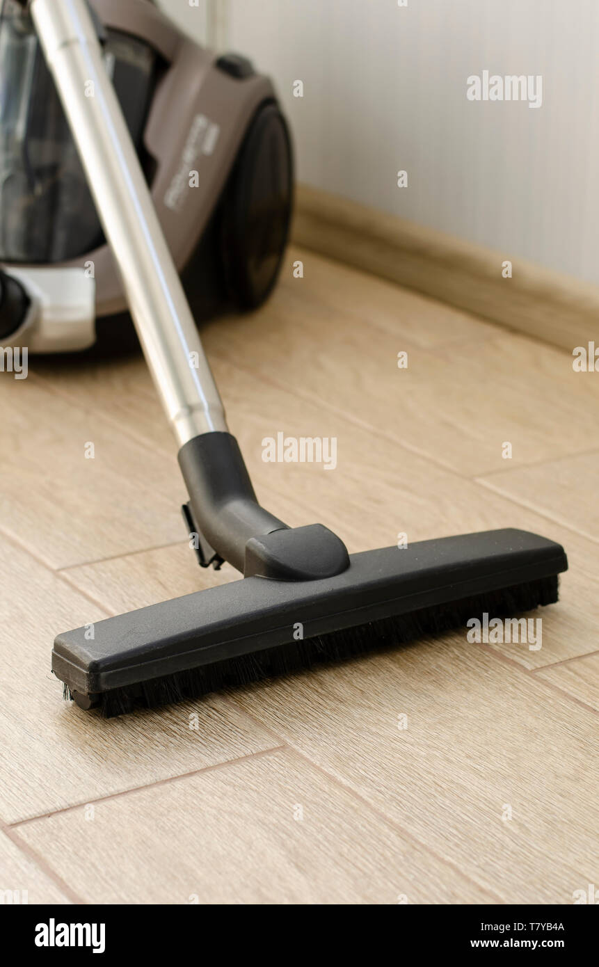 Housekeeping and cleaning concept. Vacuum cleaner nozzle on the floor. - Stock Image