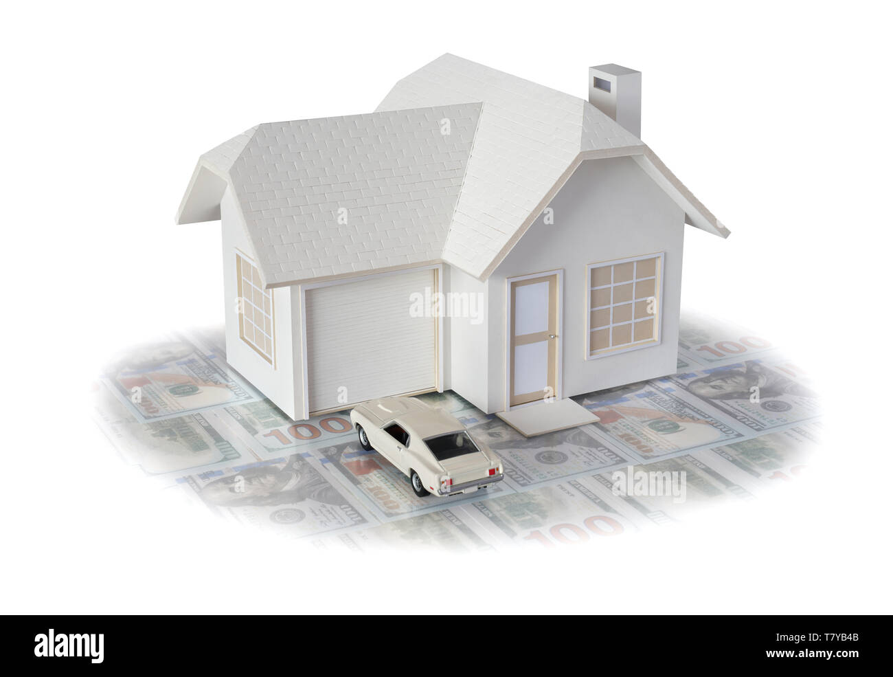 House miniature w/ car on U.S. dollar bills isolated in white background for real estate & construction concepts. House miniature made by contributor Stock Photo