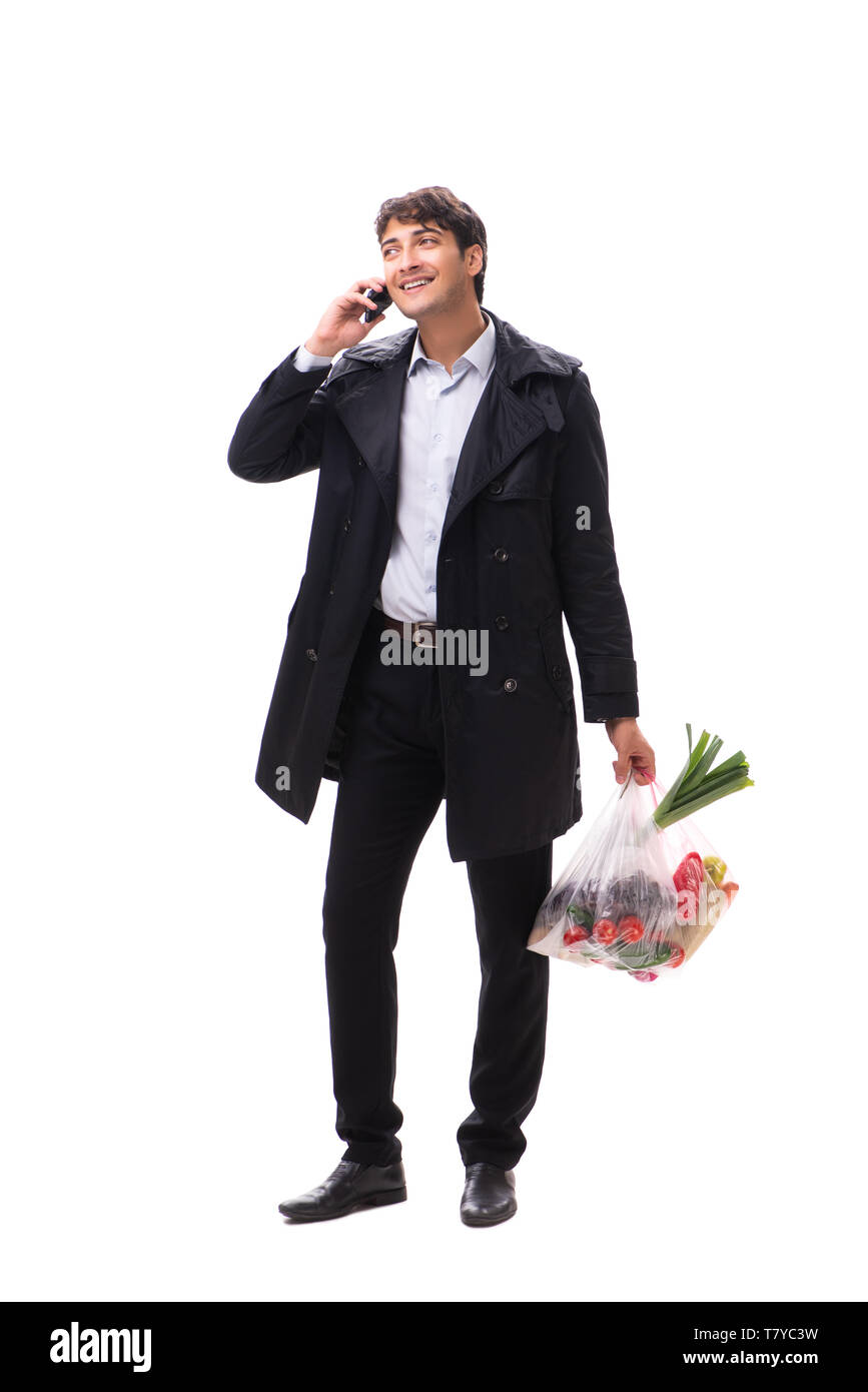 Young handsome man with vegatables in shopping concept - Stock Image