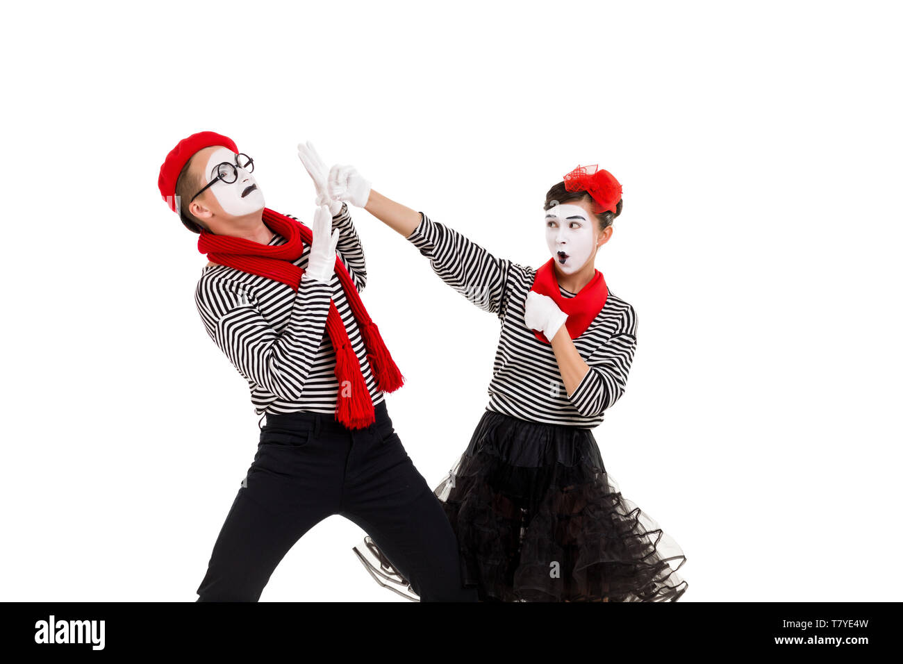 mimes in striped shirts. couple fighting each other for fun isolated on white background - Stock Image