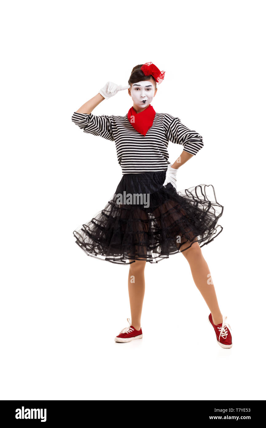 Full length portrait of a mime woman artist looking at camera and gesturing with her finger against temple asking are you crazy - Stock Image