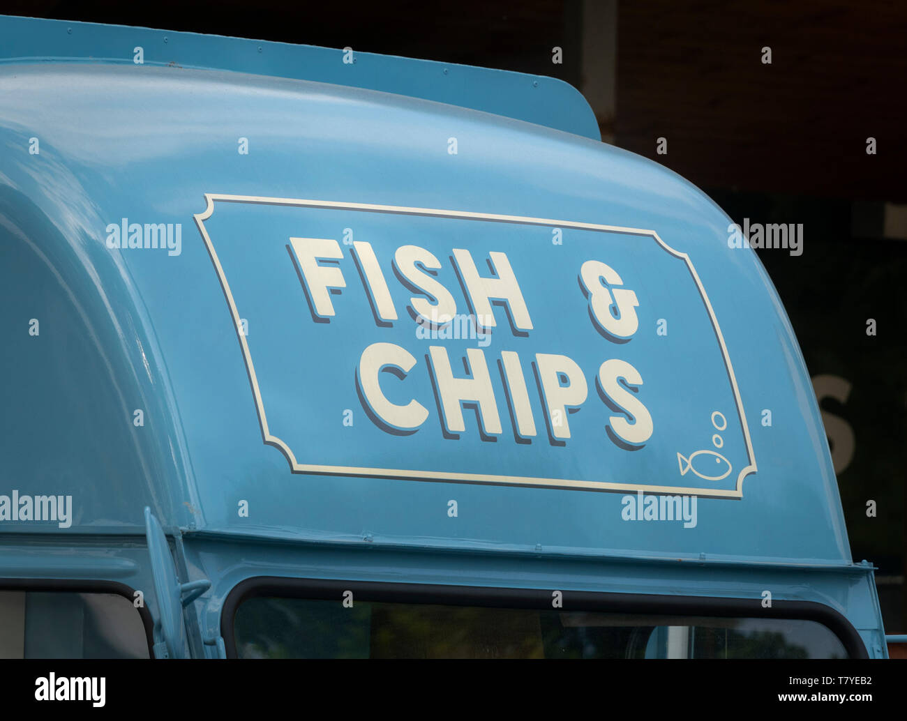 Fish and Chips sign on mobile street food van - Stock Image