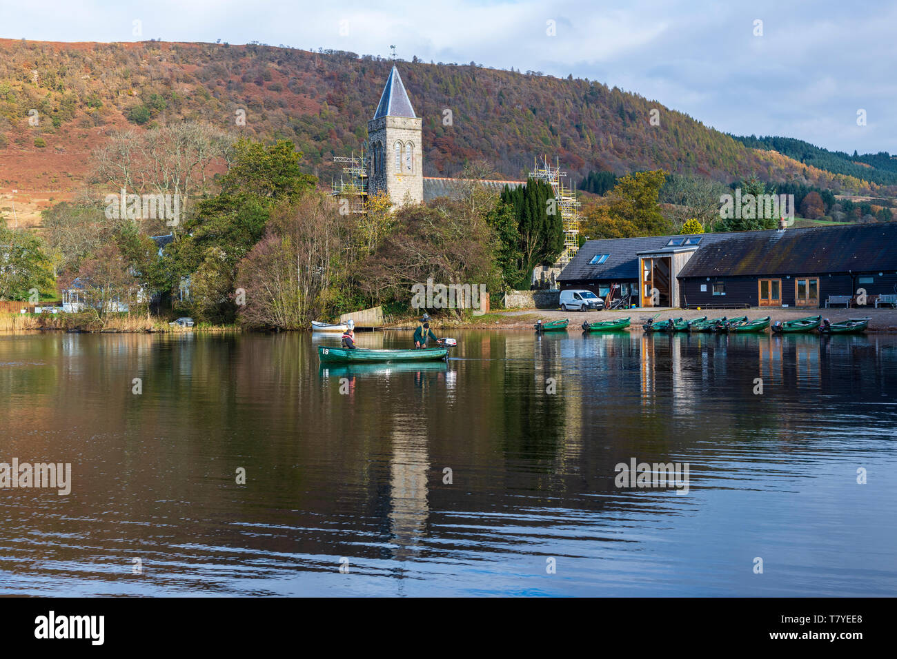 Fishermen setting off from Port of Menteith Fisheries on Lake of Menteith in the Trossachs, Scotland, UK - Stock Image