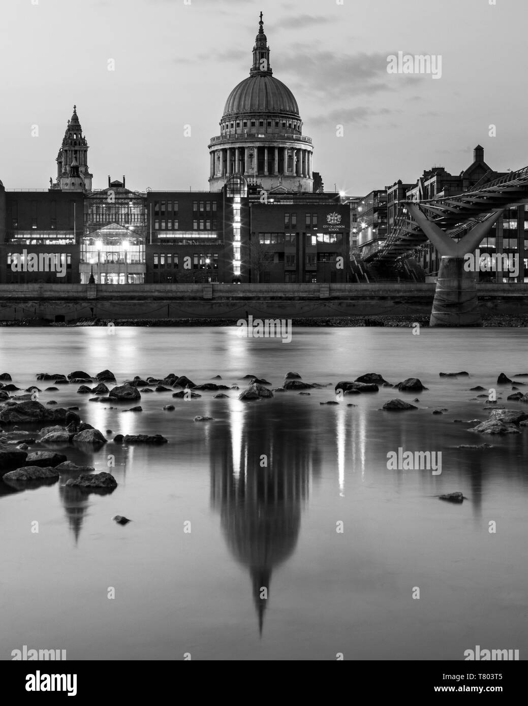 London, UK - April 1st 2019: A dusk-time view of the magnificent St. Pauls Cathedral and its reflection in the River Thames in London, UK. - Stock Image