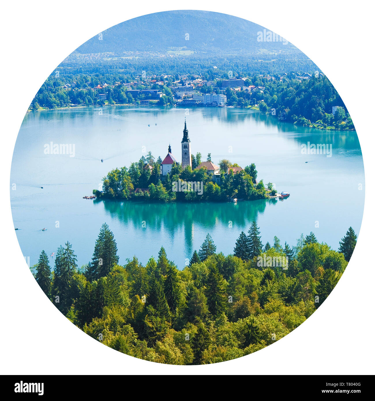Round icon of Lake Bled (the most famous lake in Slovenia) with the island of the church and the typical wooden boats, called Pletna (Europe - Sloveni - Stock Image