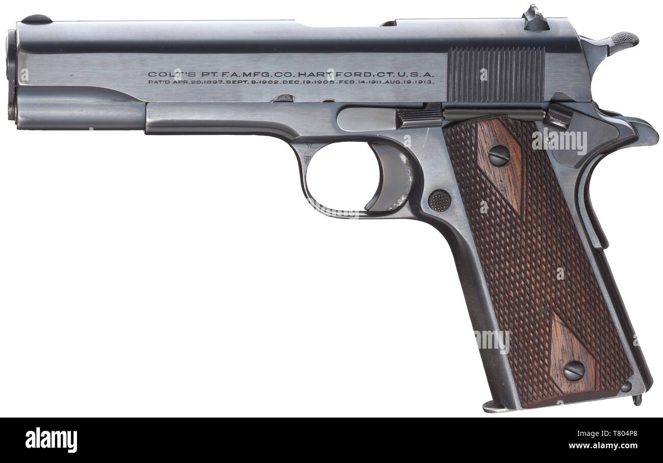 A Colt mod. 1911, cal..45 ACP, no. C112263. Bright bore. Manufactured in 1919. On left side of slide two-line corporate name and patent data, on the right 'COLT Automatic Calibre .45', on frame marked 'Government Model'. Complete, original blue-black Colt-blue, few weak wear marks on grip. Flawless walnut grip panels. Correct magazine hardened in upper third. Rare collectors' item without any different stamps in original and almost mint condition. Erwerbsscheinpflichtig. historic, historical, civil handgun, civil handguns, handheld, gun, guns, fi, Additional-Rights-Clearance-Info-Not-Available - Stock Image