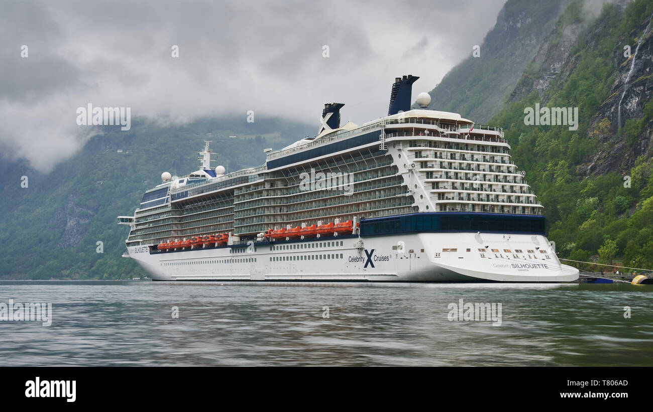 Geirangerfjord has stunning emerald-green scenery and towering high waterfalls. Celebrity Silhouette at the cruise ship Terminal. - Stock Image