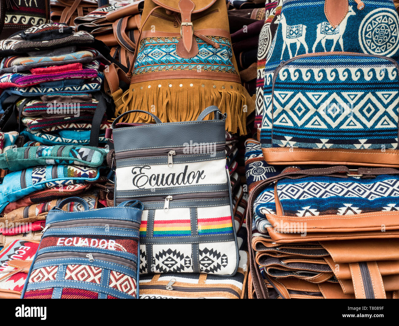 Tourist goods for sale, craft market, Plaza de los Ponchos, Otavalo, Ecuador, South America - Stock Image