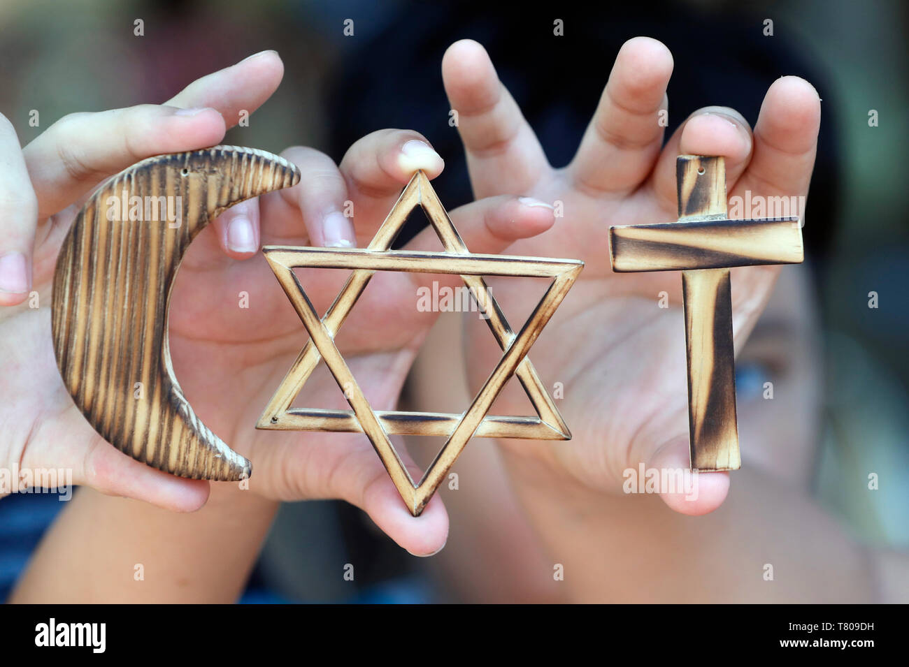 Christianity, Islam, Judaism, the three monotheistic religions with symbols of Jewish Star, Muslim Crescent and Christian Cross, Vietnam - Stock Image