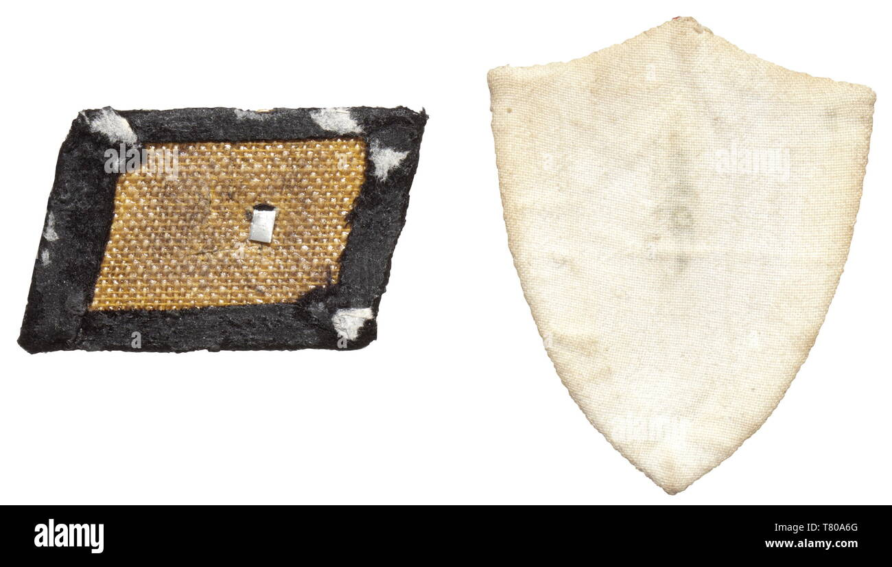 A right collar patch for enlisted men/NCOs of the 15th Waffen Grenadier Division of the SS (Latvian no. 1). Local issue of black woollen material with hand-sawn metal appliqué in the shape of a swastika. Moth traces, reverse glue residue. Included is the corresponding sleeve shield of local production in the state colours of red with diagonal white stripes. historic, historical, 20th century, 1930s, 1940s, secret service, security service, secret services, security services, police, armed service, armed services, NS, National Socialism, Nazism, Third Reich, German Reich, Ge, Editorial-Use-Only Stock Photo
