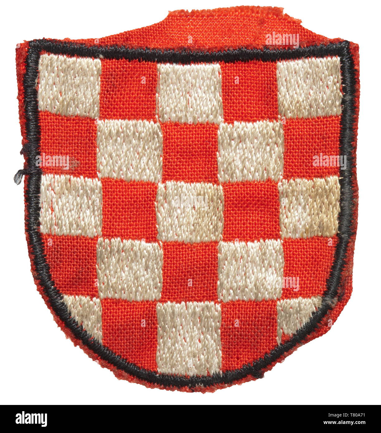 "A sleeve shield for Croatian volunteers in the 13th Waffen Mountain Division of the SS ""Handschar"" (Croatian no. 1) or the 23rd Waffen Mountain Division of the SS ""Kama"" (Estonian no. 2). Machine-embroidered issue in red cotton cloth. historic, historical, 20th century, 1930s, 1940s, secret service, security service, secret services, security services, police, armed service, armed services, NS, National Socialism, Nazism, Third Reich, German Reich, Germany, utensil, piece of equipment, utensils, object, objects, stills, clipping, clippings, cut out, cut-out, cut-outs, fasci, Editorial-Use-Only Stock Photo"