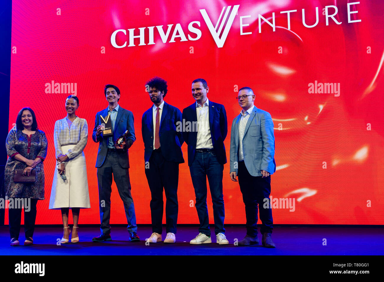 (L to R) Chivas Venture judge and Executive Director of the Beeck Center for Social Impact and innovation Sonal Shah, Chivas Venture Judge Zoe Saldana, Chivas Venture Award Winner Javier Larragoiti of Xilinat, BAFTA winning actor Richard Ayoade, Alexandre Ricard chairman and CEO of Pernod Ricard and Chivas Venture judge and Founder of Change Please Cemal Ezel seen posing for a group photo at the Chivas Venture Global Final at TNW Conference. The 14th edition of the TNW conference was inaugurated in Amsterdam at the NDSM, a creative hub for artists and entrepreneurs. Every year, this global com - Stock Image