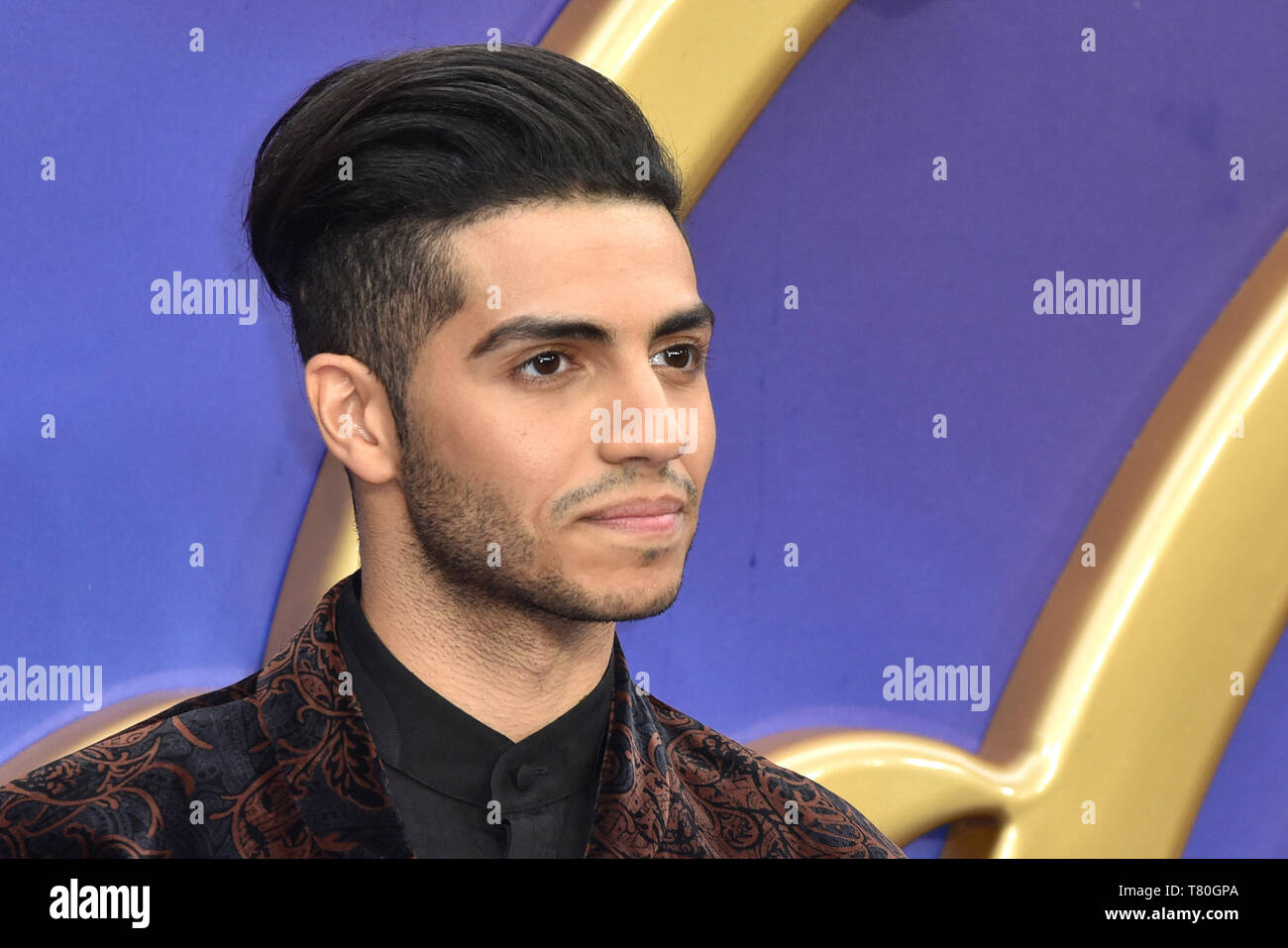 Mena Massoud attends the European Gala of 'Aladdin' at the Odeon Luxe Leicester Square in London, England. - Stock Image