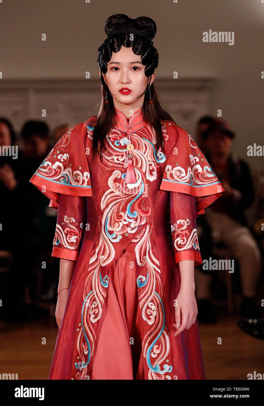 London, UK. 8th May, 2019. A model walks the runway during the Zhejiang Traditional Craft Innovation Exhibition at Asia House in London, Britain on May 8, 2019. Organized by the Zhejiang Provincial Department of Culture and Tourism, the exhibition is a part of the fifth London Crafts Week and will last for four days. Credit: Han Yan/Xinhua/Alamy Live News Stock Photo