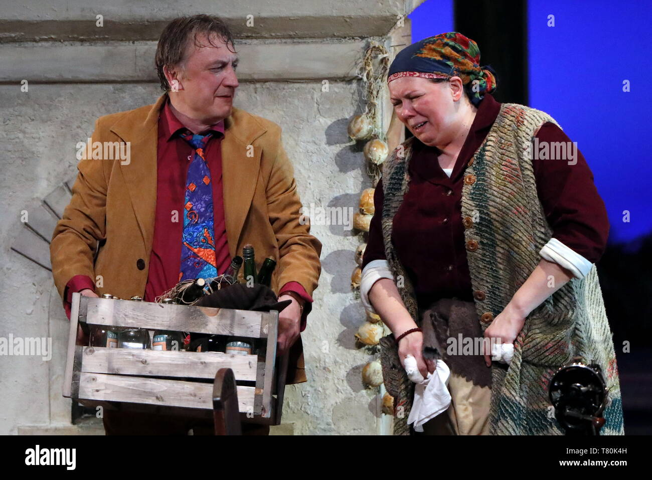 MOSCOW, RUSSIA - MAY 8, 2019: Andrei Zaikov as Ilya (L) and Natalya Morgunova as Varvara in a scene during the premiere of The Last Term, a stage adaptation of the namesake novel by writer Valentin Rasputin, directed by Sergei Puskepalis, at the Gorky Moscow Art Theatre (MKhAT). Sergei Karpukhin/TASS - Stock Image