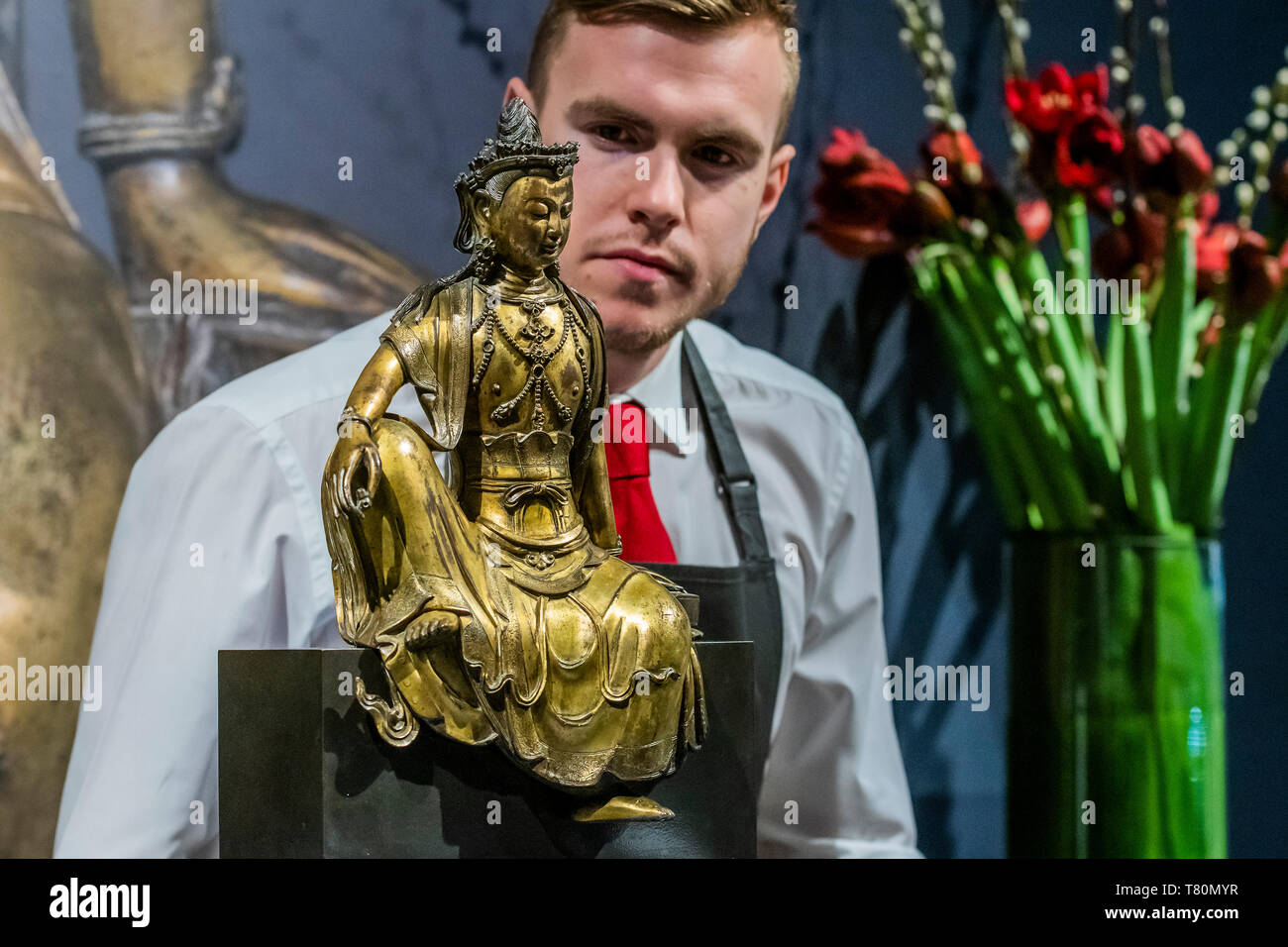 London, UK. 10th May, 2019. An early Ming Dynasty gilt-broinze seated figure of Bodhisattva, est £300-500,000 - Preview of Christie's Spring Asian Art Auctions in London. Credit: Guy Bell/Alamy Live News - Stock Image