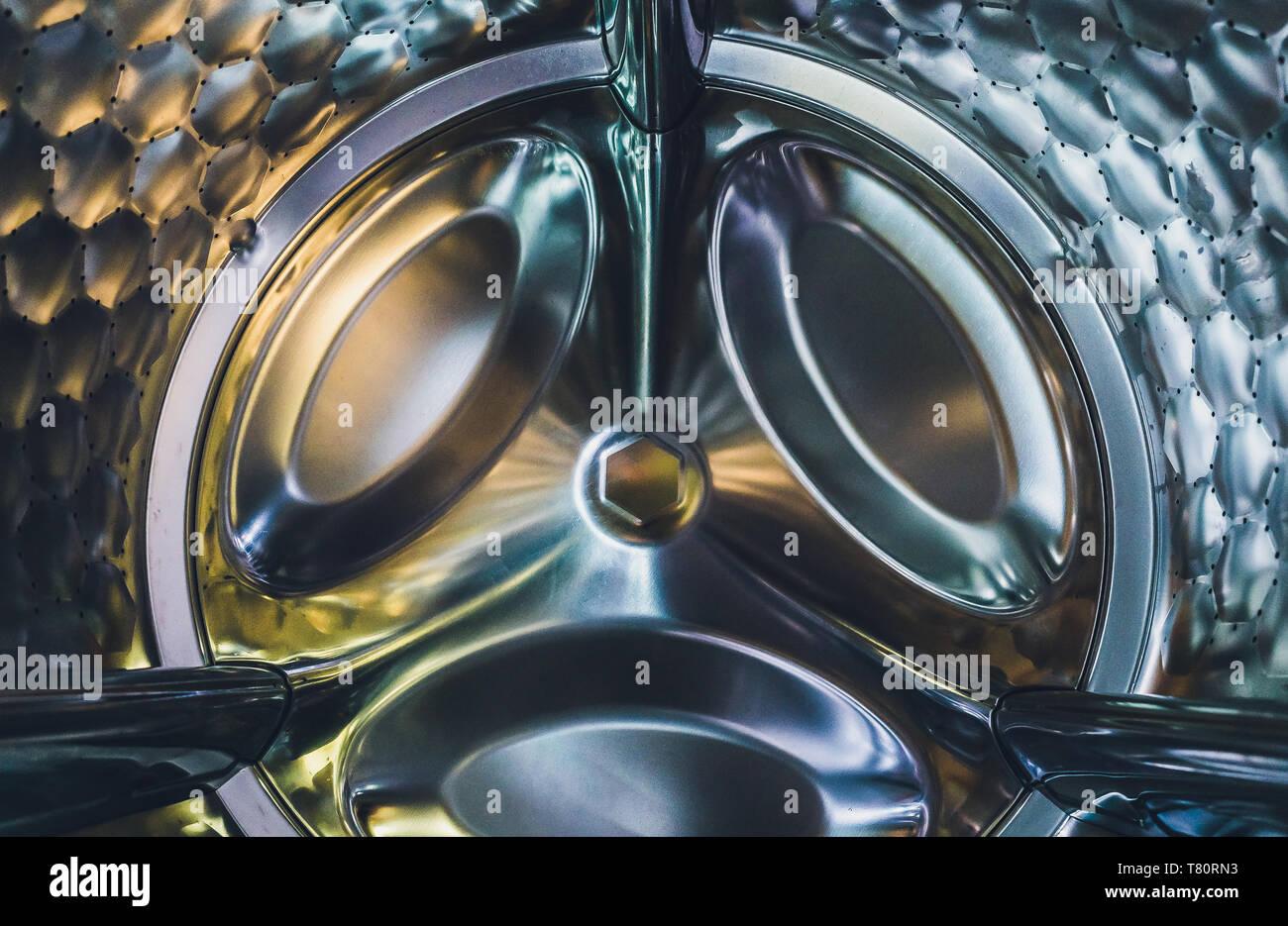 Washing machine drum interior, Internal view of an empty washing machine drum - Stock Image