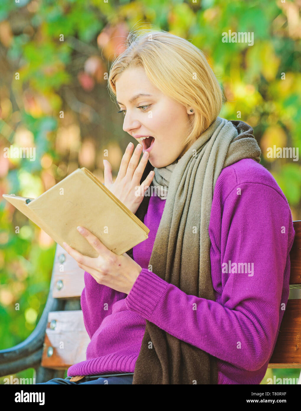 keen on reading. Time for review. further education. i learn for myself. woman read interesting book in spring park. Enjoying new chapter. Leave all your worries behind. She has got a book she needs. - Stock Image