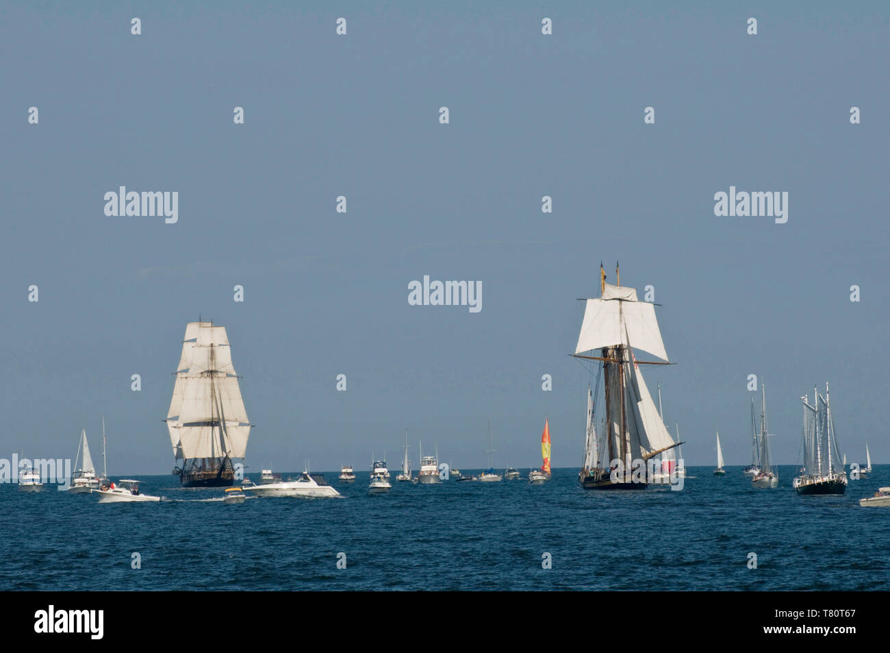 Duluth, Minnesota. Tall ships enter the port of Duluth on Lake Superior to be part of the Duluth Maritime Festival. The ships are a replica of the war - Stock Image