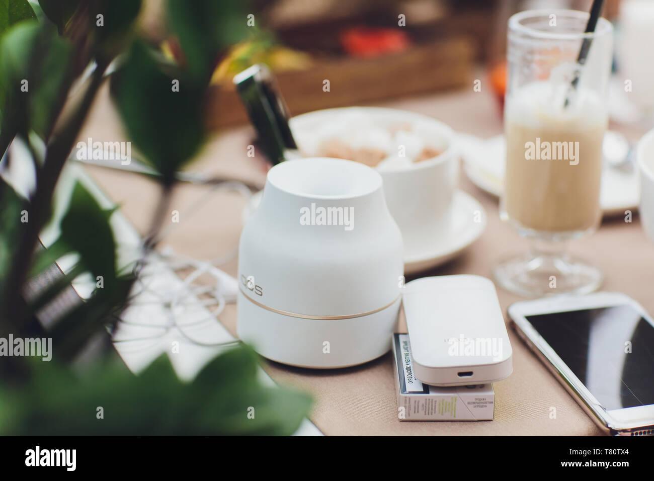 Ufa, Russia - April 11, 2019: E-cigarette accessories stick ashtray - Stock Image