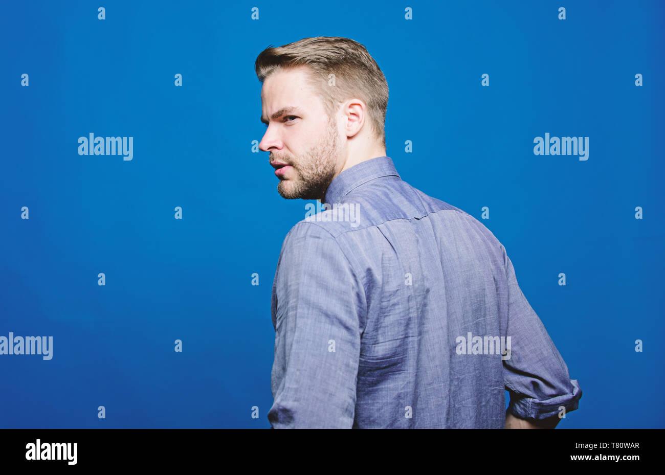 Barber and beard care. Beard grooming salon. Barber salon. Beard grooming. Get ready for date. Hipster denim shirt looks attractive blue background. Man well groomed beard. Well groomed macho. - Stock Image