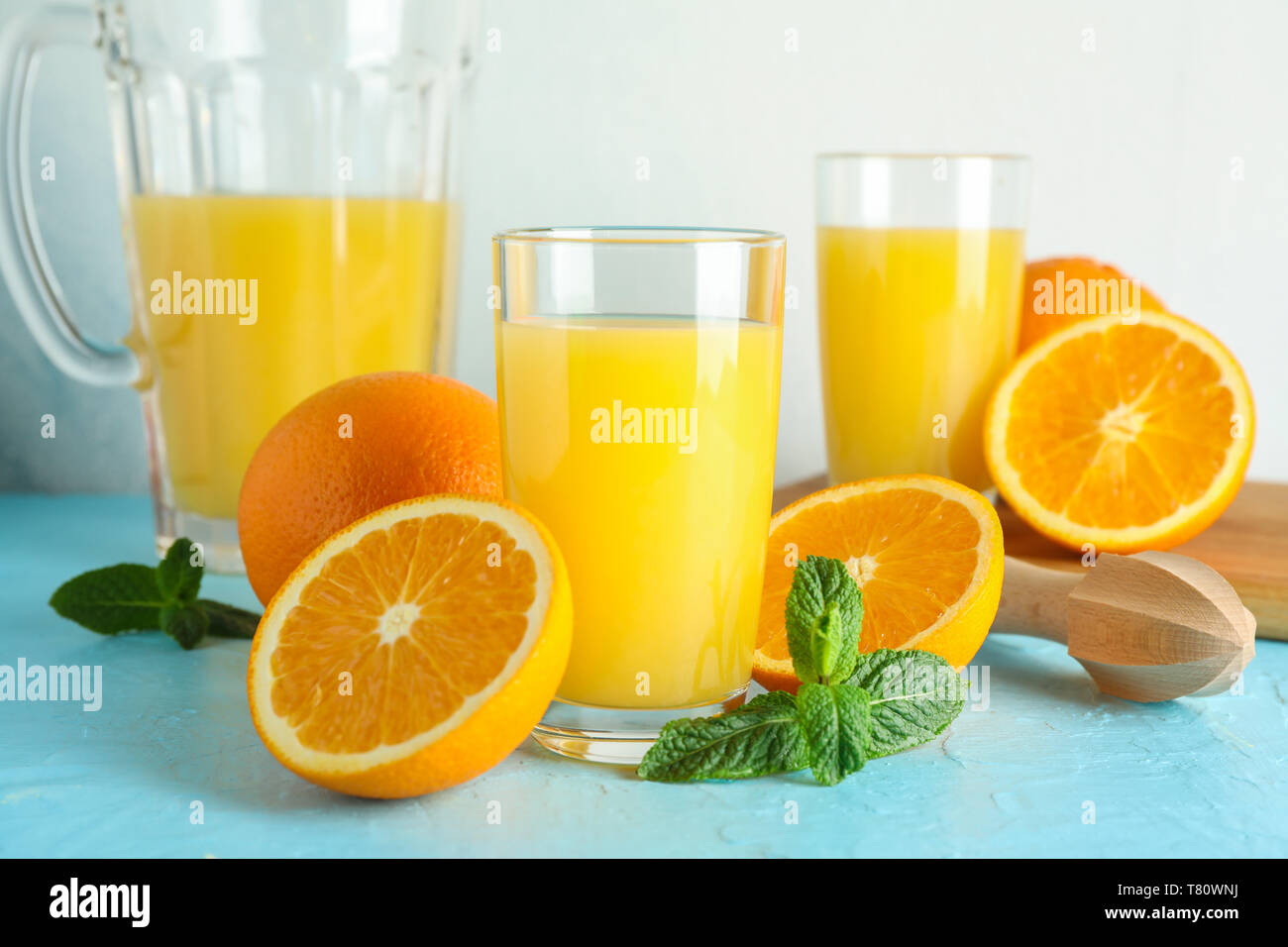 Composition With Fresh Orange Juice In Glassware Mint And Wooden Juicer On Color Table Against White Background Closeup Fresh Natural Drink Stock Photo Alamy,What Colour Is Orange And Blue