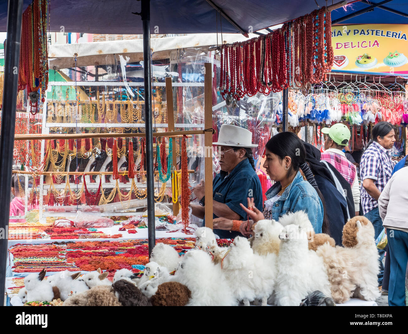 Goods for sale, market, Plaza de los Ponchos, Otavalo, Ecuador, South America - Stock Image