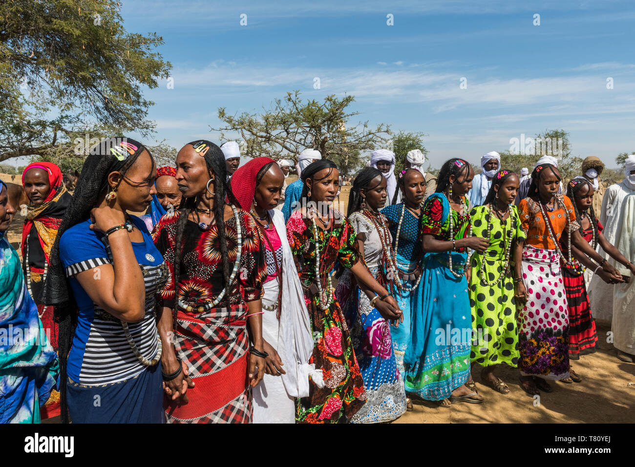 Colourful dressed women at a tribal festival, Sahel, Chad, Africa - Stock Image