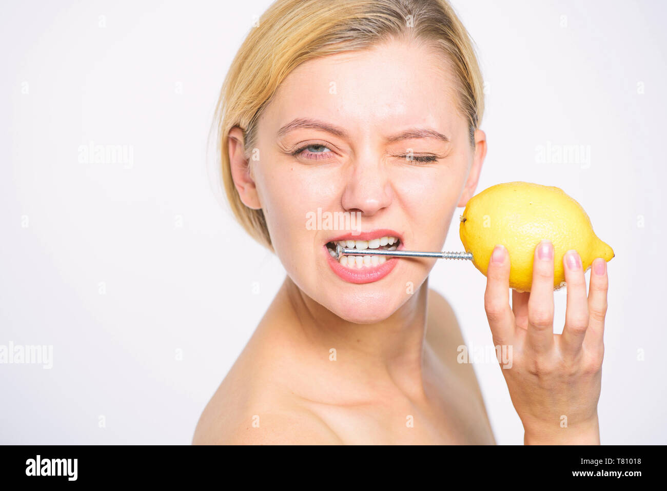 Recharge your body vitamins. Girl drink fresh juice whole lemon fruit. Energy source and vitality. Battery concept. Nutritious drink fill with energy. Lemon with hobnail natural battery. - Stock Image