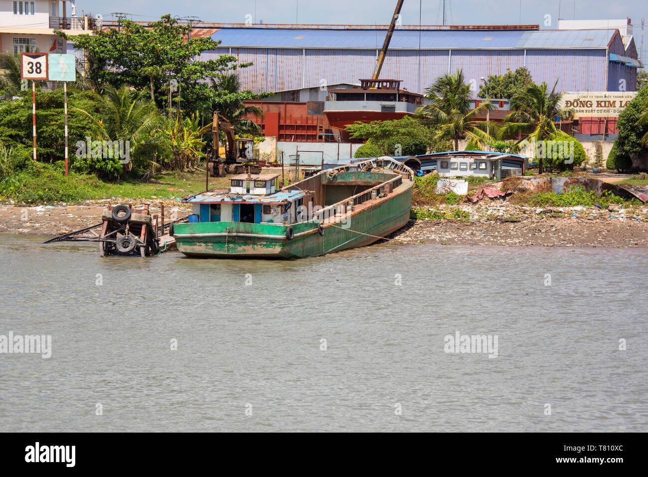 A boatyard on the Mekong River, Vietnam - Stock Image