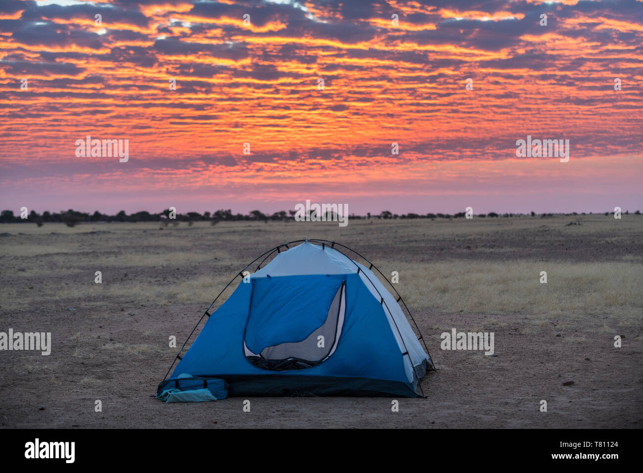 Camping under a dramatic morning sky in the Sahel, Chad, Africa Stock Photo