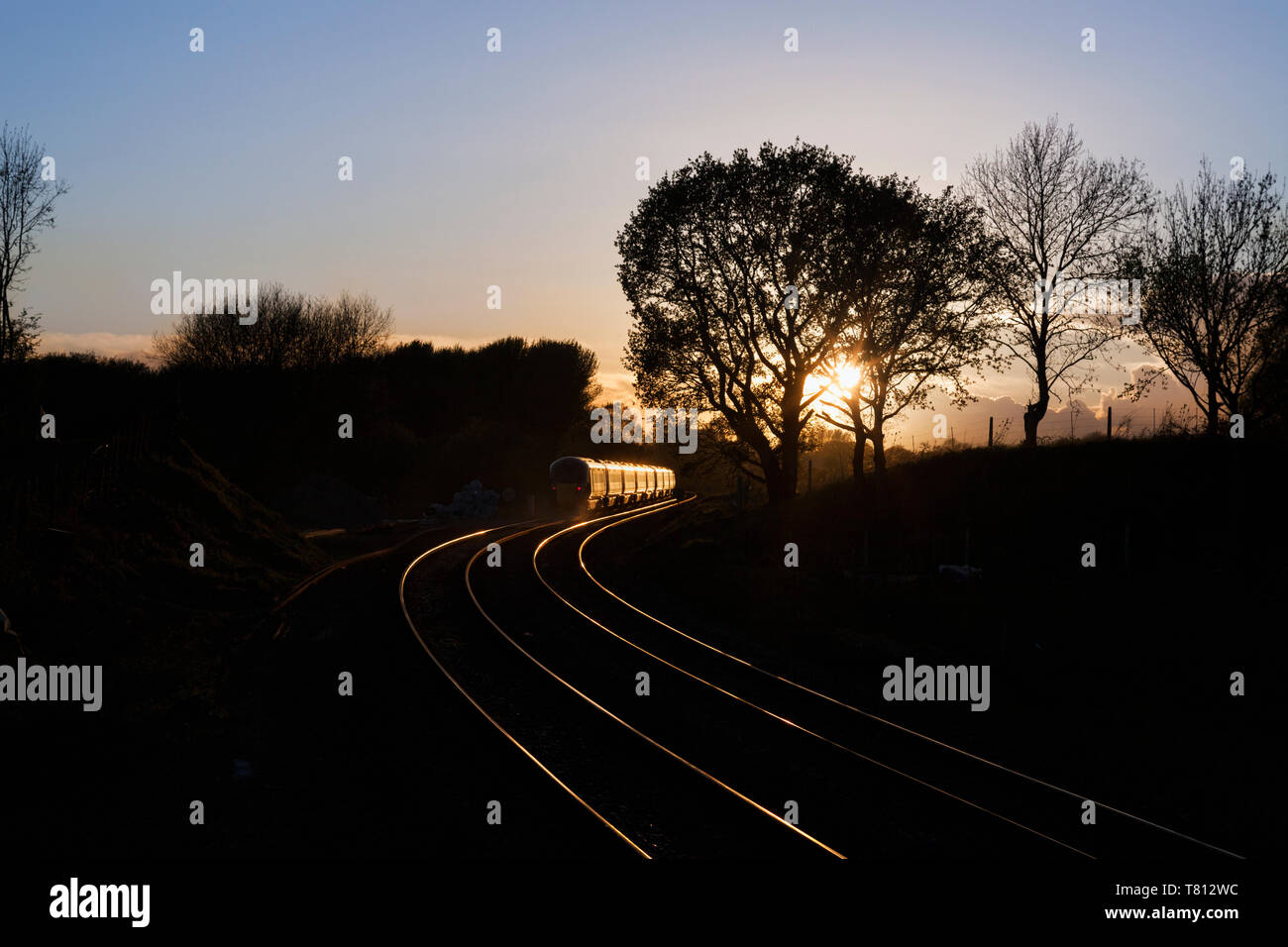 2 First Great Western railway Hitachi Intercity Express trains  ( IEP ) head into the sunset at Crofton, Wiltshire - Stock Image